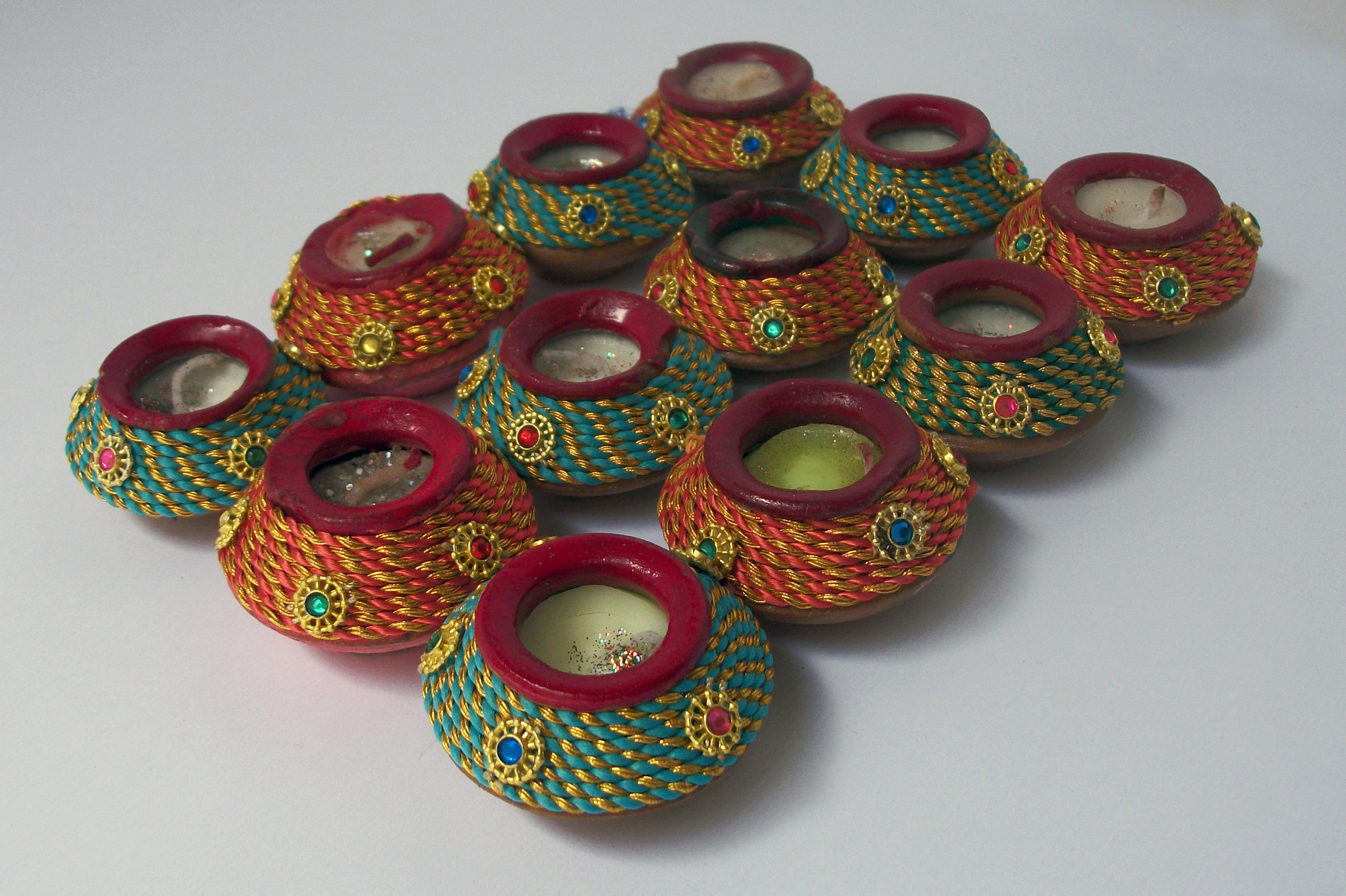5ec12a9ce45 It is the most important decorative item in Diwali decorations as Diwali is  the festival of lights. Get beautiful crafted and colored diyas or earthen  lamps ...