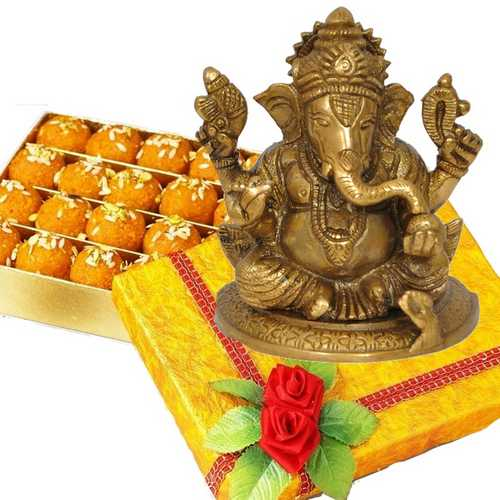 Laddoo Ganesha Surprise - Brass Ganesh Idol