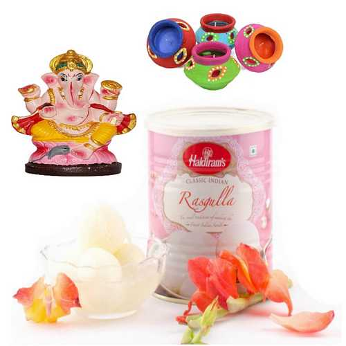 Rasgulla for Diwali with Ganesh Idols and Decorated Diyas