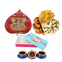 Hanging Brass Ganesh Idol with Kaju Katli and Dry Fruits